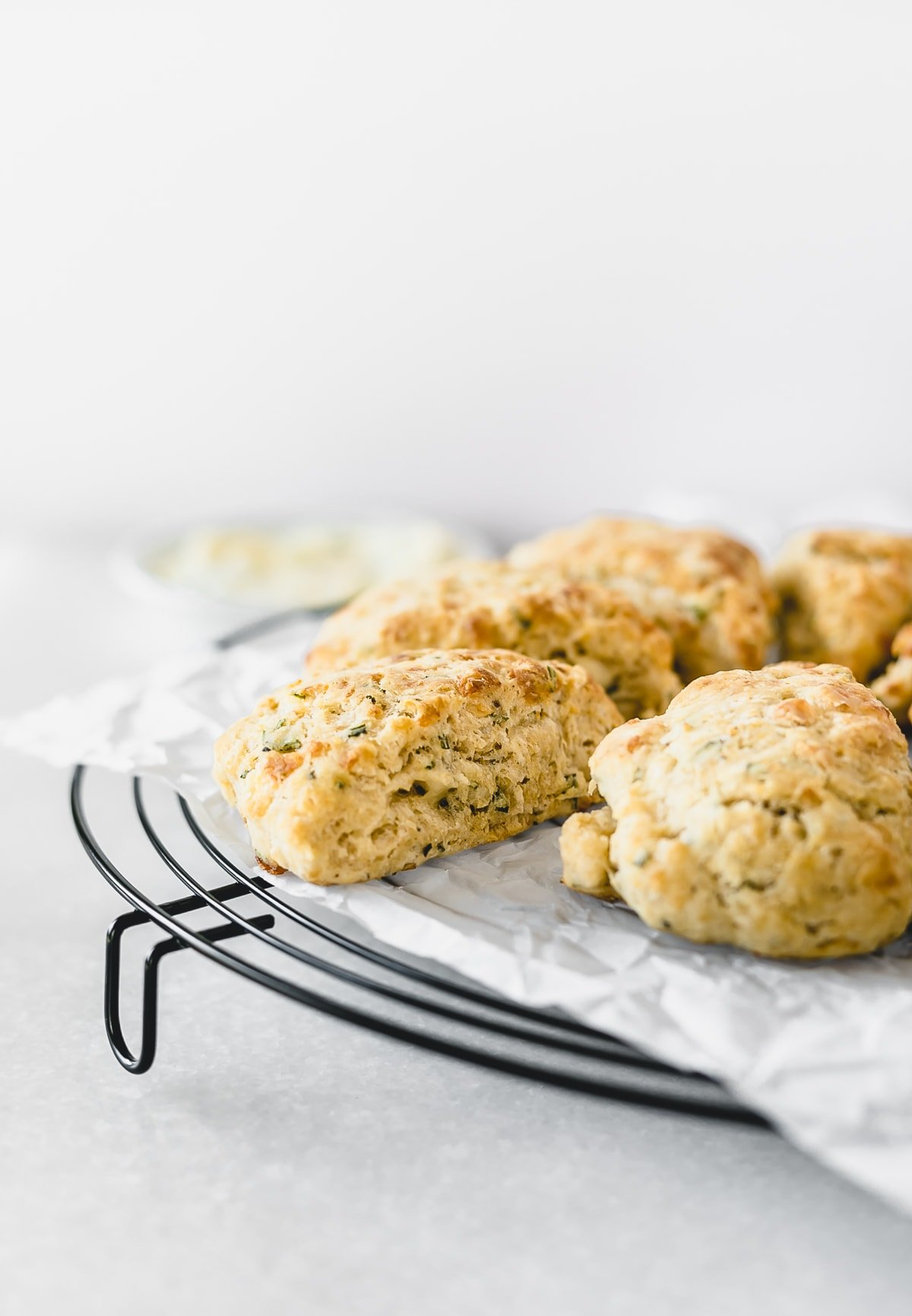 Whole grain Rosemary Parmesan Scones with Herb butter are a delicious savory treat, perfect for a snack with any meal! | via livelytable.com