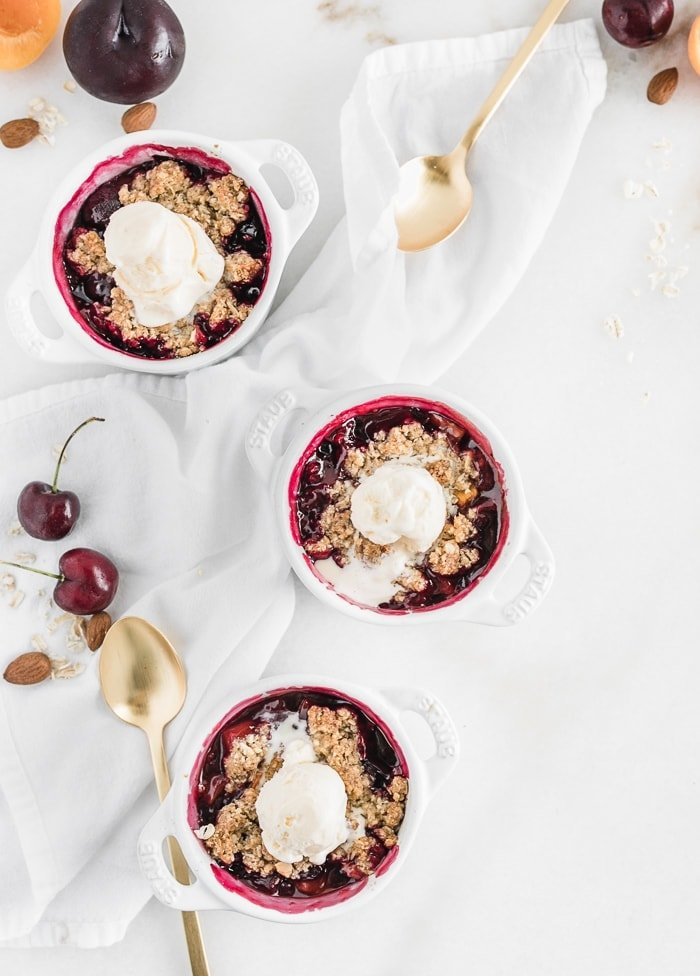Sone fruit cobbler with ice cream on top.