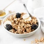 Healthy 6-Ingredient Quinoa Granola is a healthier version of granola with crunchy clusters that's delicious for a snack or on top of yogurt for breakfast. via livelytable.com