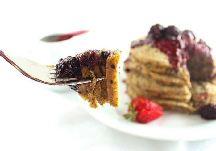 Healthy quinoa pancakes that are naturally gluten-free and perfect with an easy berry compote. It's a delicious weekend breakfast! via livelytable.com