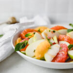 This refreshing grapefruit citrus salad made with granny smith apples and mint is the perfect healthy summer fruit salad! (gluten-free, vegan, no added sugar) | via livelytable.com
