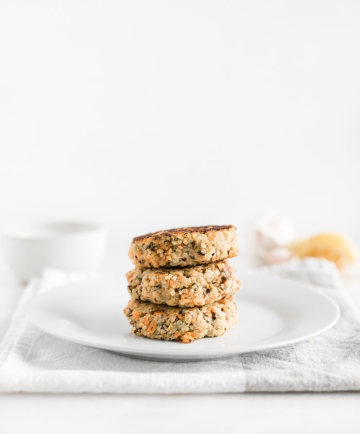 easy quinoa salmon burger patties stacked on a plate