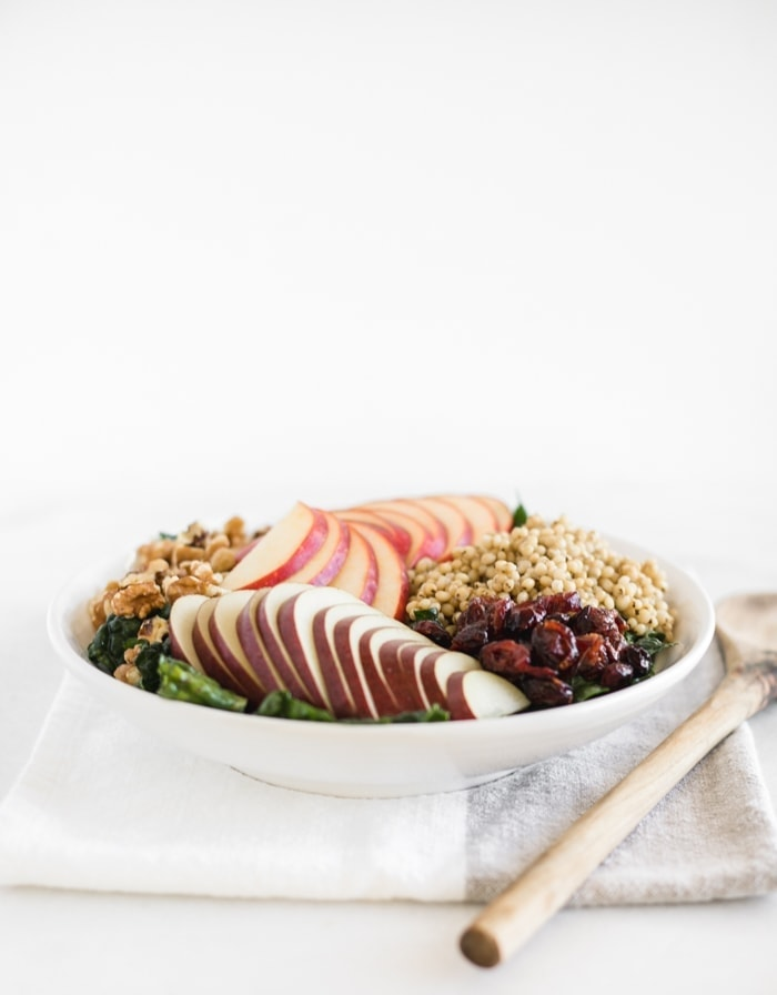 fall kale salad with sorghum, apples, pears, and cranberries