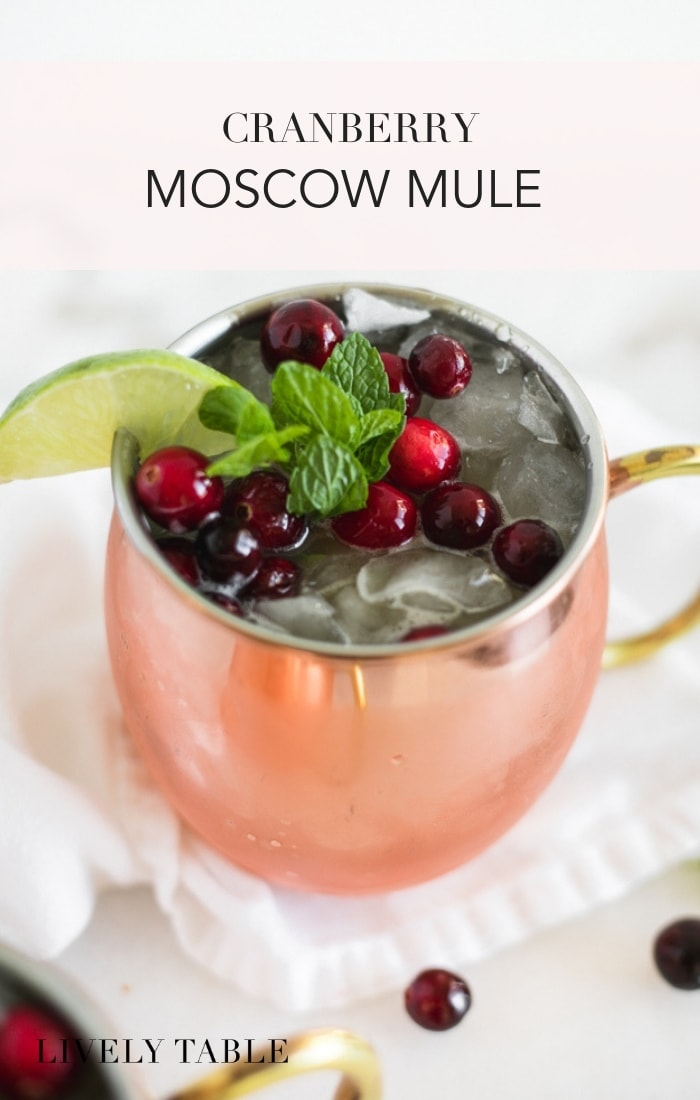 Get in the holiday spirit with a festive Cranberry Moscow Mule! This Christmas cocktail with vodka, cranberries, limeand ginger beer is an easy and delicious crowd pleaser.#cocktails #drinks #cranberry #holidaydrinks