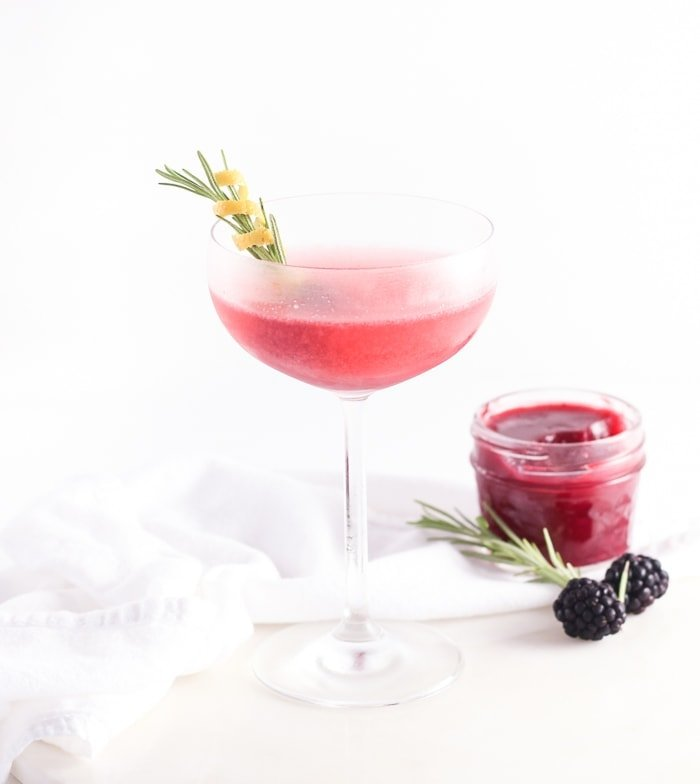 This Blackberry Gin and Jam couldn't be easier to make! A delicious 6-ingredient winter gin cocktail made with sweet marionberry jam, lemon, St. Germain and rosemary, perfect for entertaining! | via livelytable.com