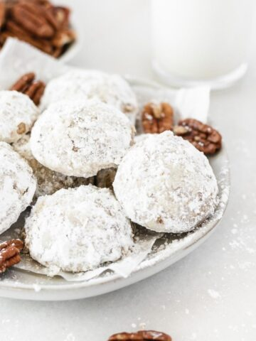 Christmas Pecan Snowball Cookies are as easy to make as they are delicious! Bring these Christmas cookies to your holiday parties or set them out for Santa for a very merry Christmas! #desserts #holidaytreats #cookies