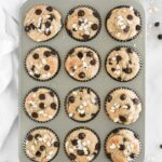 overhead view of baked healthy banana chocolate chip blender muffins in a muffin tin.