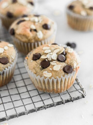 Healthy gluten free banana chocolate chip blender muffin on a cooling rack.