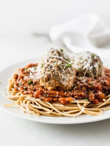 gluten free italian beef quinoa meatballs with sauce in a bowl