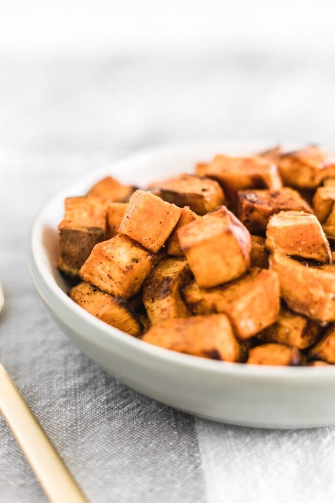closeup of simple roasted sweet potato cubes in a great bowl