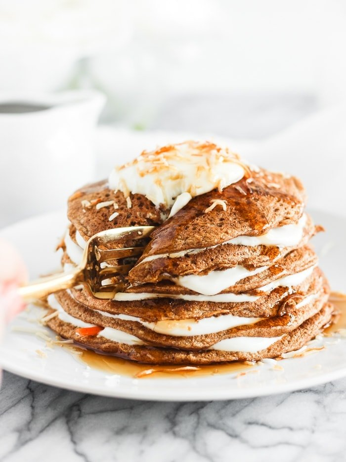 healthy carrot cake pancakes with lightened up cream cheese frosting