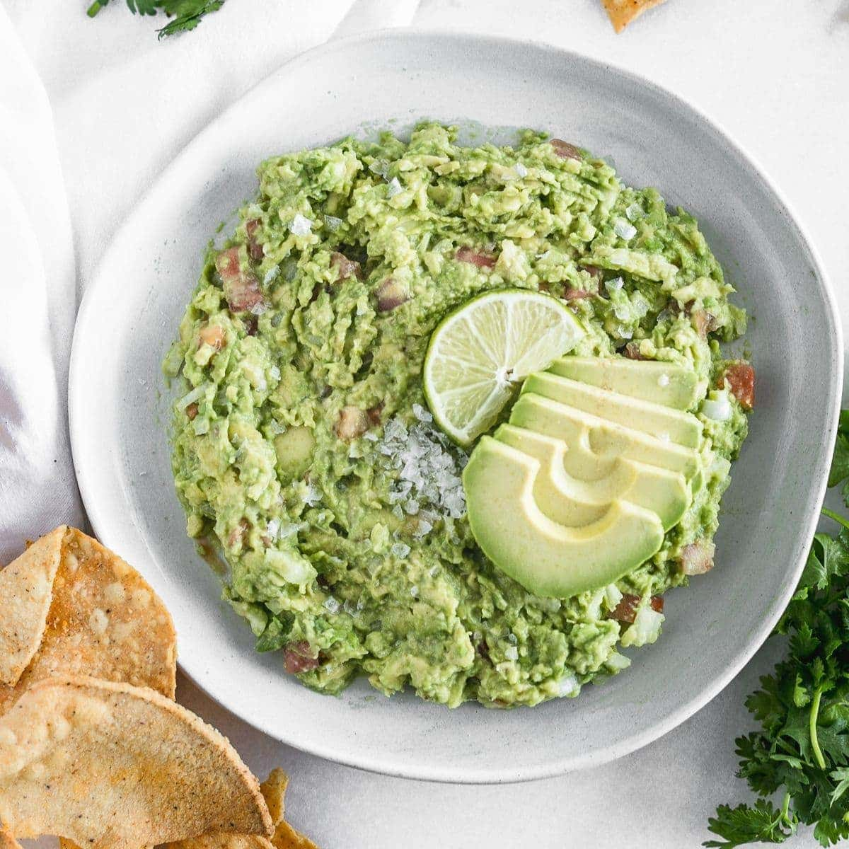 This easy guacamole recipe has just a few simple ingredients and is the perfect healthy dip to accompany any Tex-Mex dish! (gluten-free, dairy-free, nut-free, vegan)