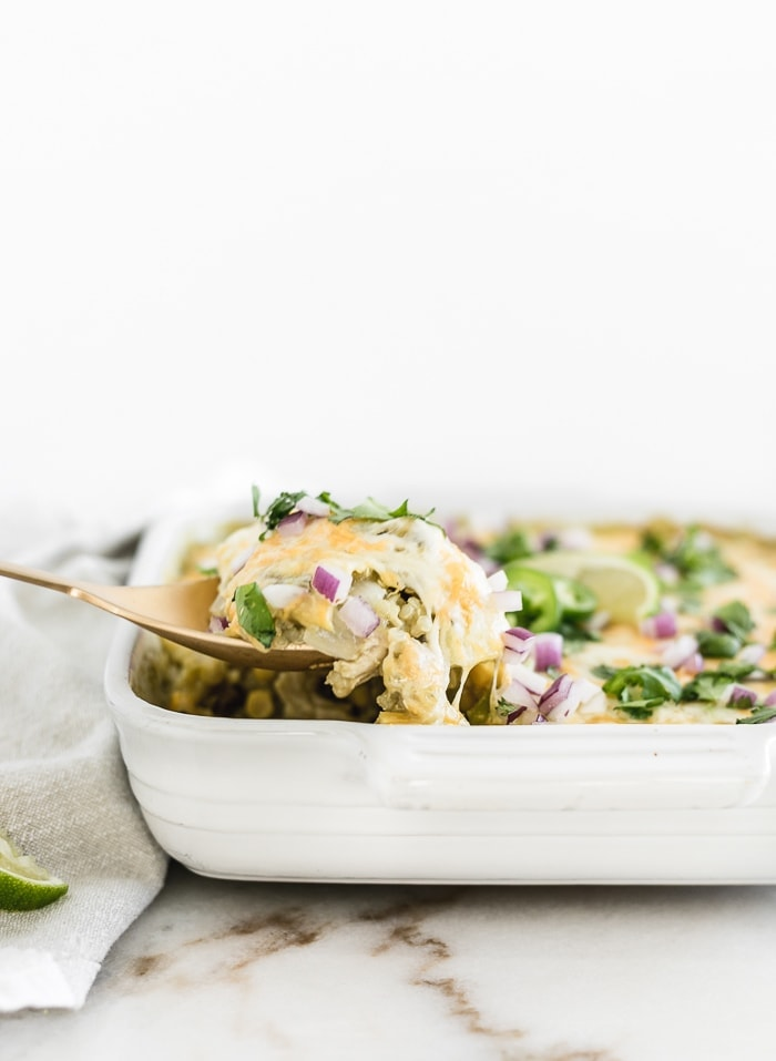 A spoon full of chicken enchilada quinoa casserole.
