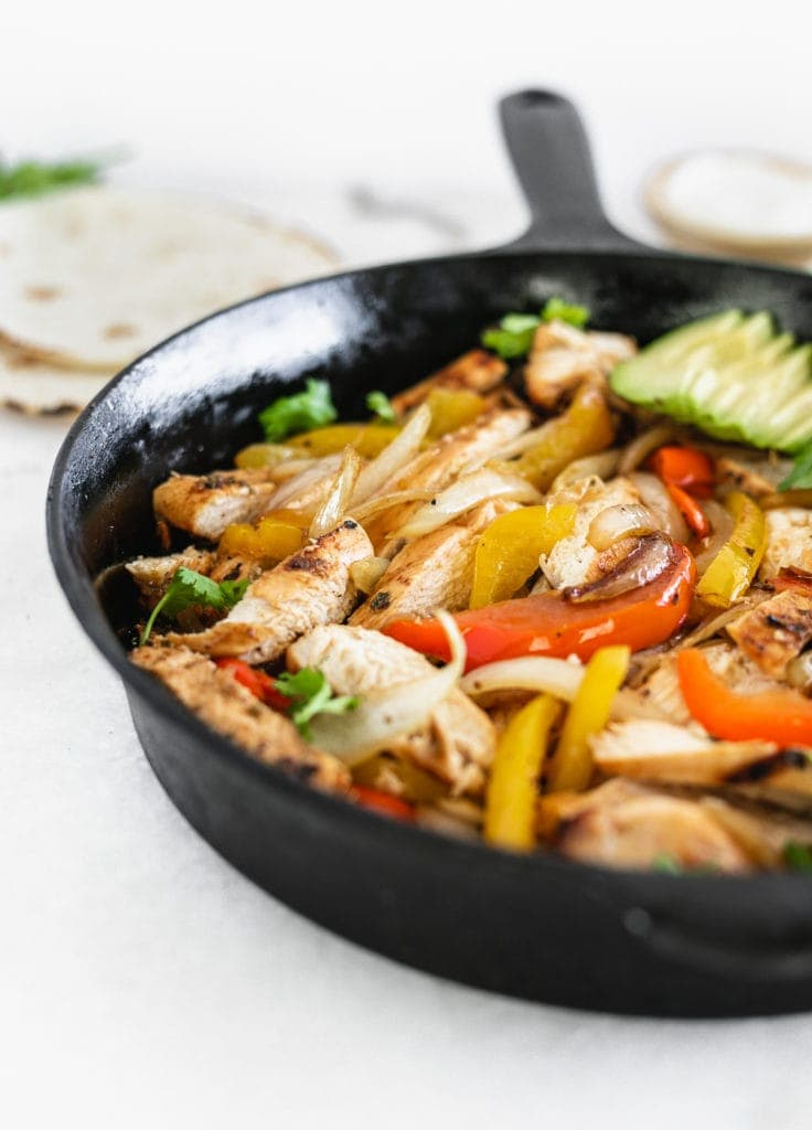 close up of easy grilled chicken fajitas in a skillet.