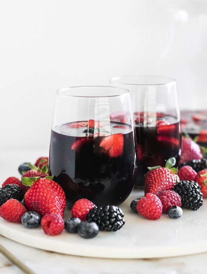 Antioxidant berry Sangrias on a tray with berries.