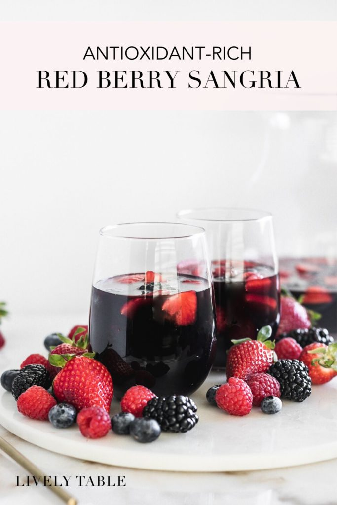 Antioxidant red berry sangrias on a plate with berries.