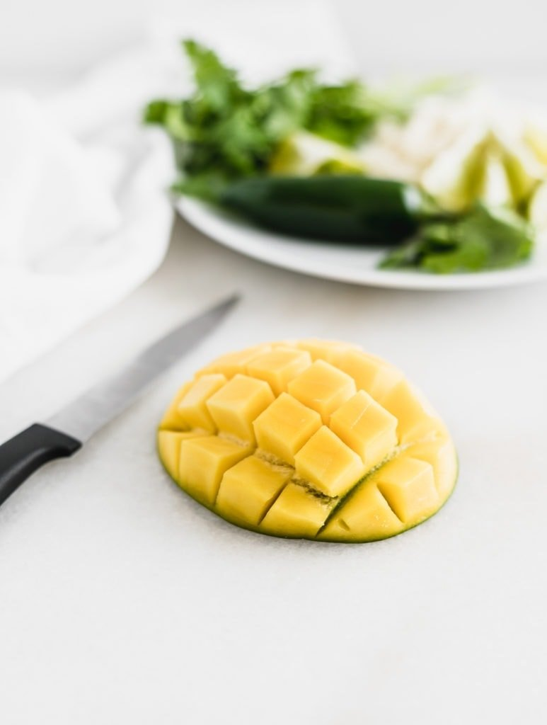 Fresh mango cut into pieces.