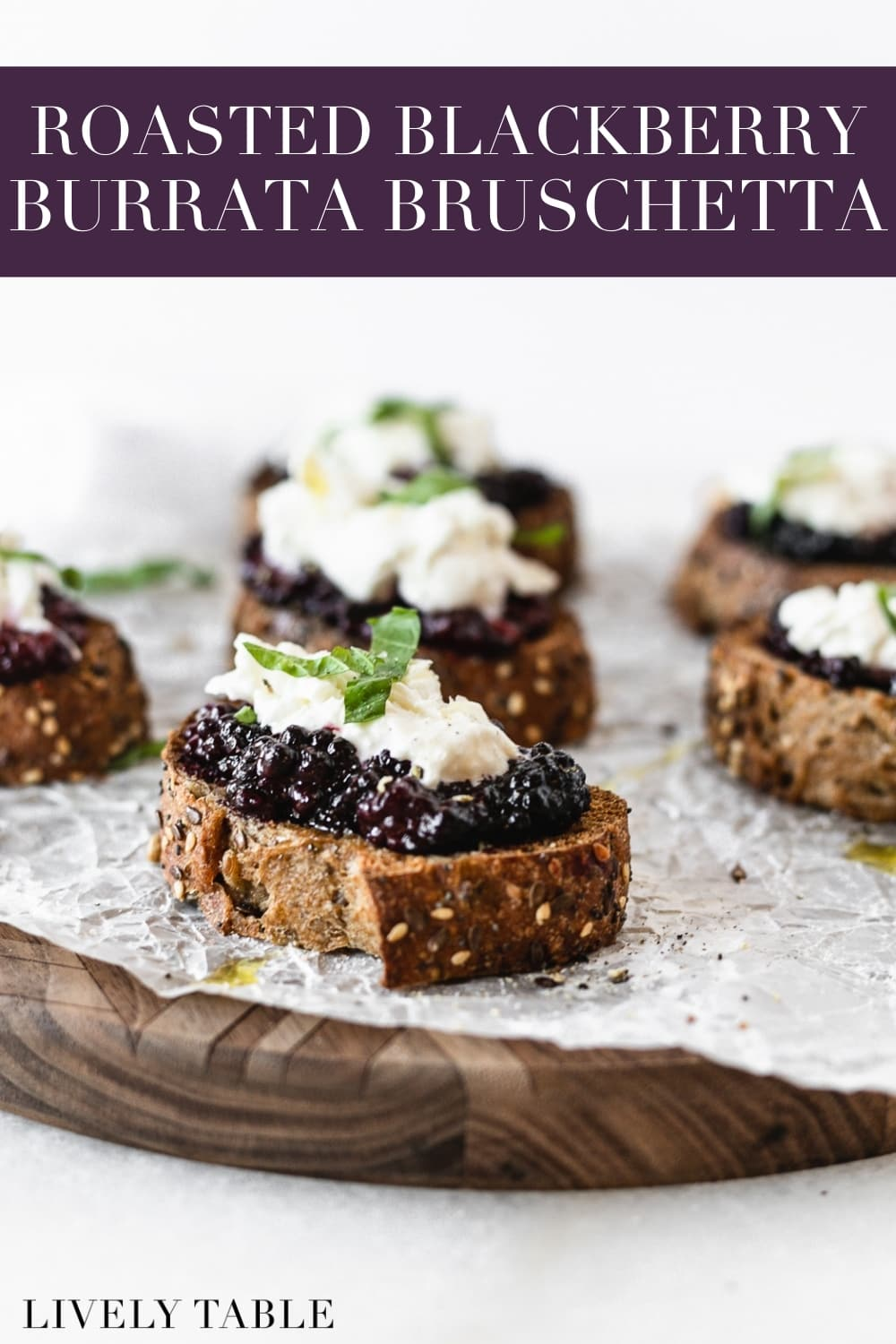 Roasted berries and creamy burrata cheese are a delicious combination atop crisp sourdough toast in this Balsamic Roasted Berry Bruschetta with Burrata. It's a simple summer appetizer that can be made quickly for guests! (#nutfree) #bruschetta #appetizer #berries #summer #recipes #burrata
