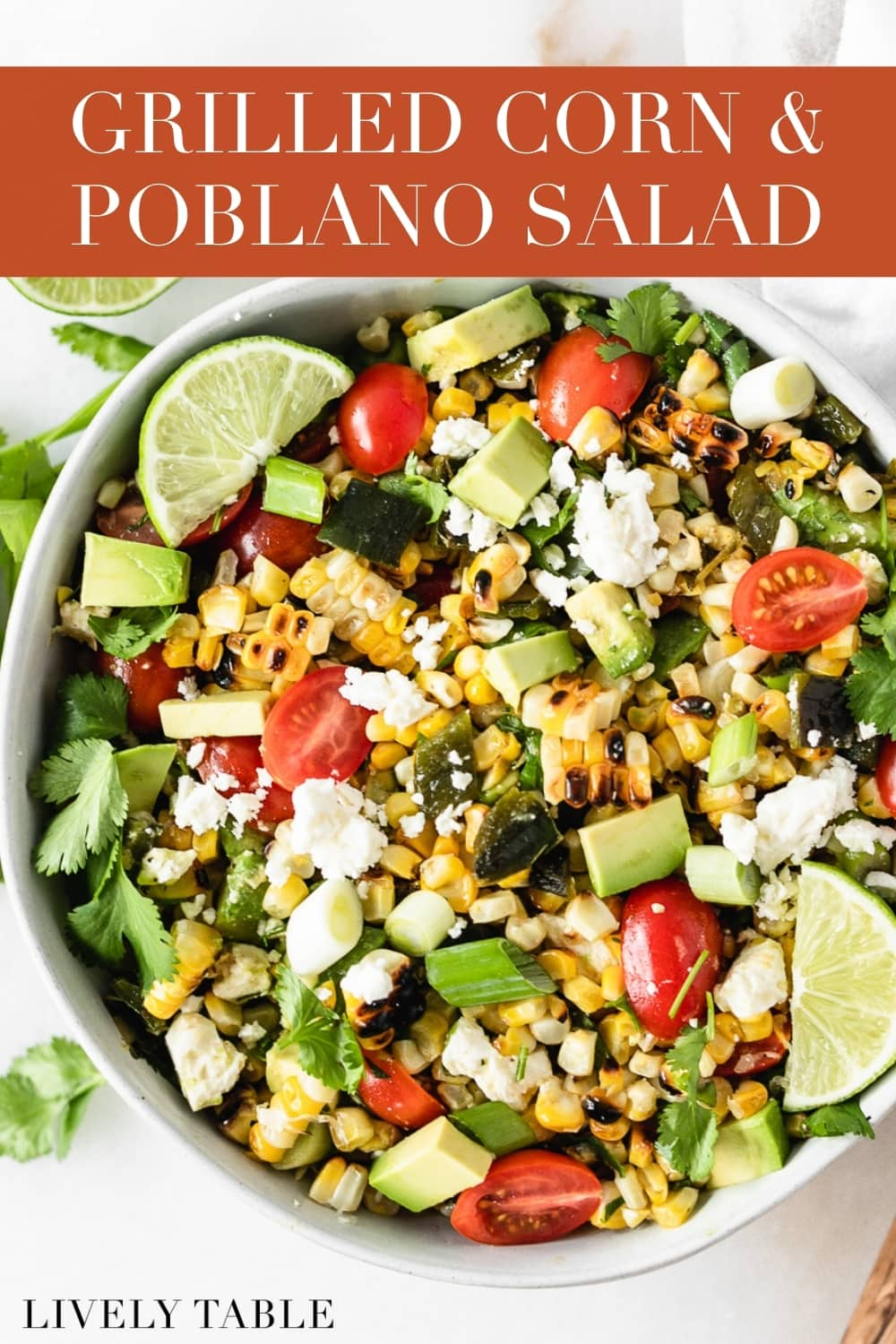 This grilled corn summer salad features grilled fresh corn and poblanos with fresh tomatoes and avocado for a delicious summer salad that's perfect for cookouts! #glutenfree #vegetarian #grilledcorn #summersalad #under30 #easy #nonboringlunch #grilledrecipes