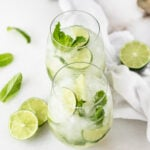 Skinny White Wine Mojitos are light, refreshing, minty, and the perfect cocktail for sipping by the pool this summer! (no added sugar, vegan, gluten-free) | via livelytable.com