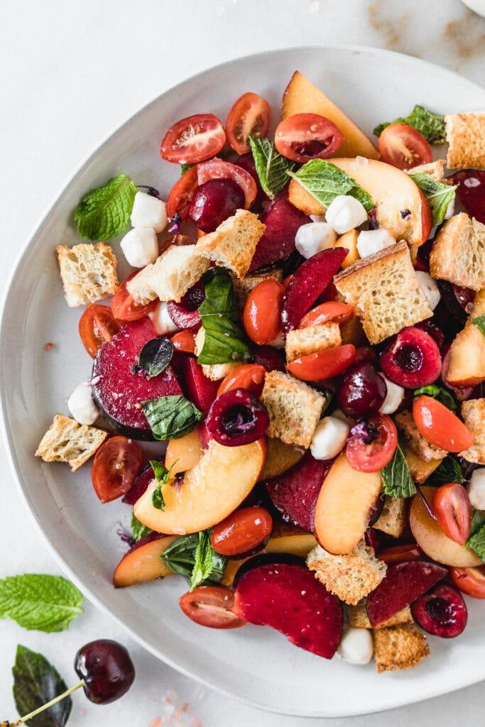 closeup overhead view of stone fruit panzanella salad