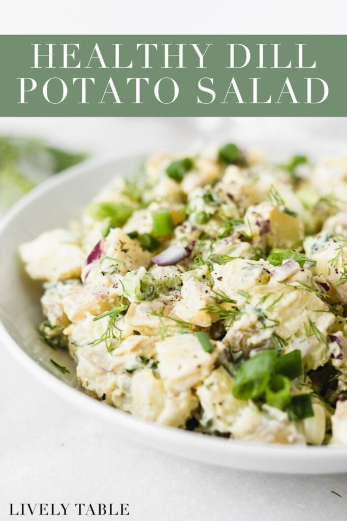 closeup of dill potato salad in a white bowl with text overlay.