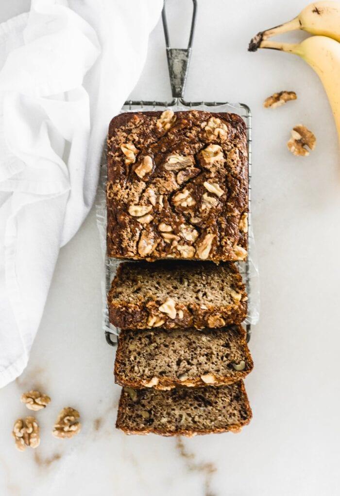 Healthy banana nut bread loaf sliced.