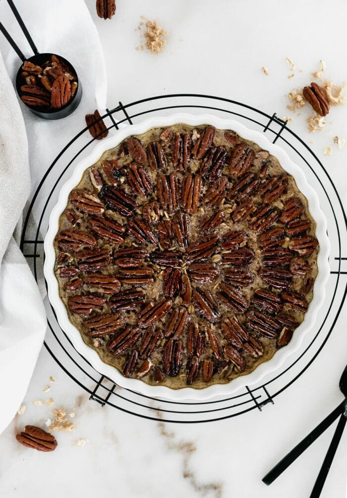 Healthy pecan pie baked oatmeal in a baking pan.