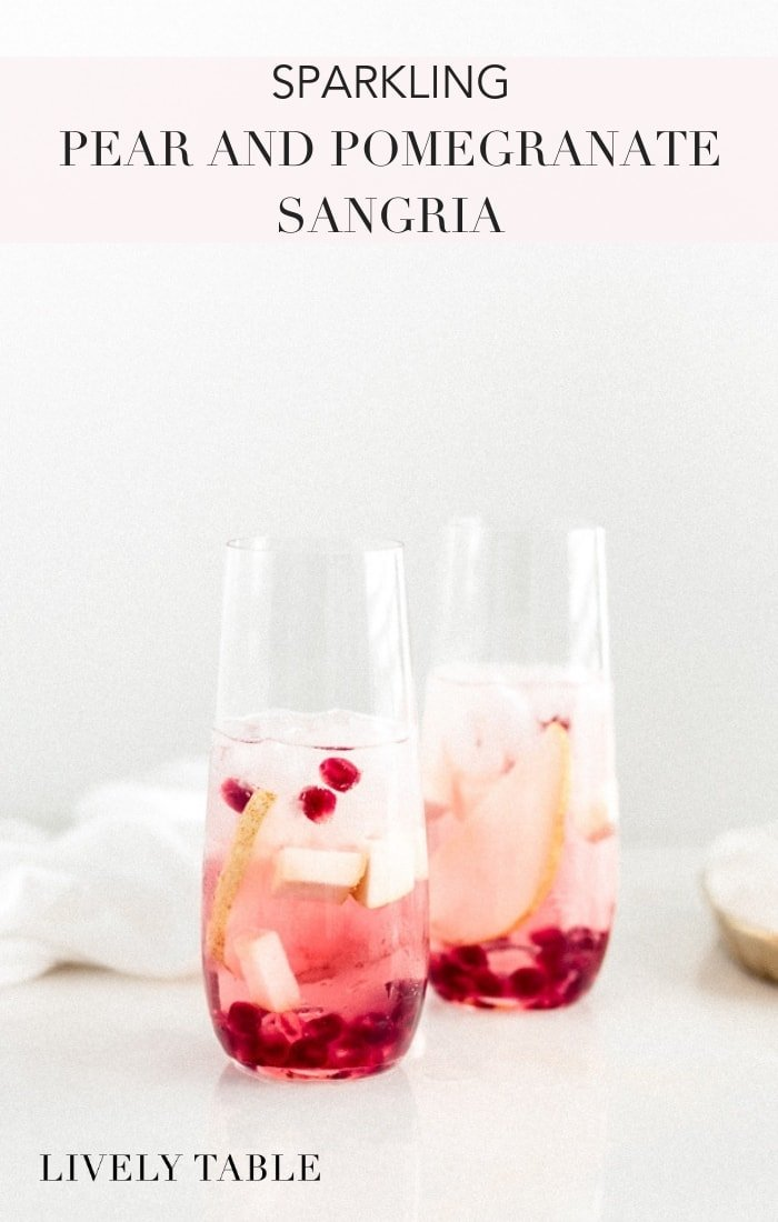 A light and delicious cocktail, Sparkling Pear and Pomegranate Sangria is the perfect festive drink to serve for the holidays! #cocktails #holidaycocktails #sangria #pearcocktails #pomegranatecocktails