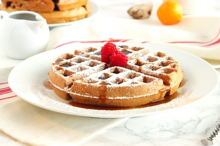 Healthy gingerbread waffles with crispy exteriors and fluffy insides are the perfect Christmas morning brunch! (dairy-free) via livelytable.com