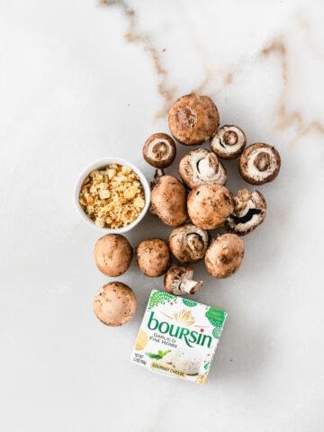 Easy boursin stuffed mushrooms on a white appetizer plate.