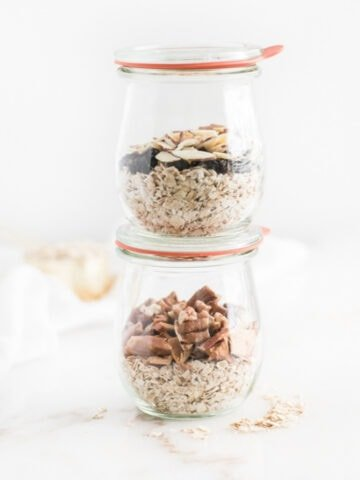 two jars of instant oatmeal stacked on top of each other.