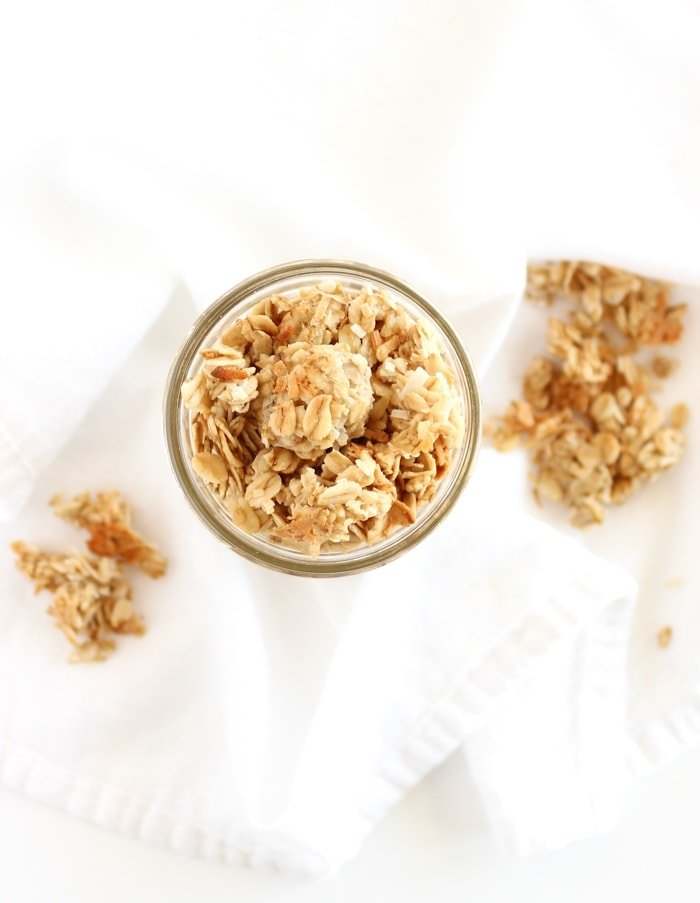 Healthy and delicious Coconut Tahini Granola with big crunchy clusters and a slightly sweet flavor is perfect for topping yogurt or snacking on by the handful! (vegan, gluten-free) via livelytable.com