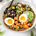 rainbow buddha bowls with farro, sweet potato, beets, brussels sprouts, and avocado