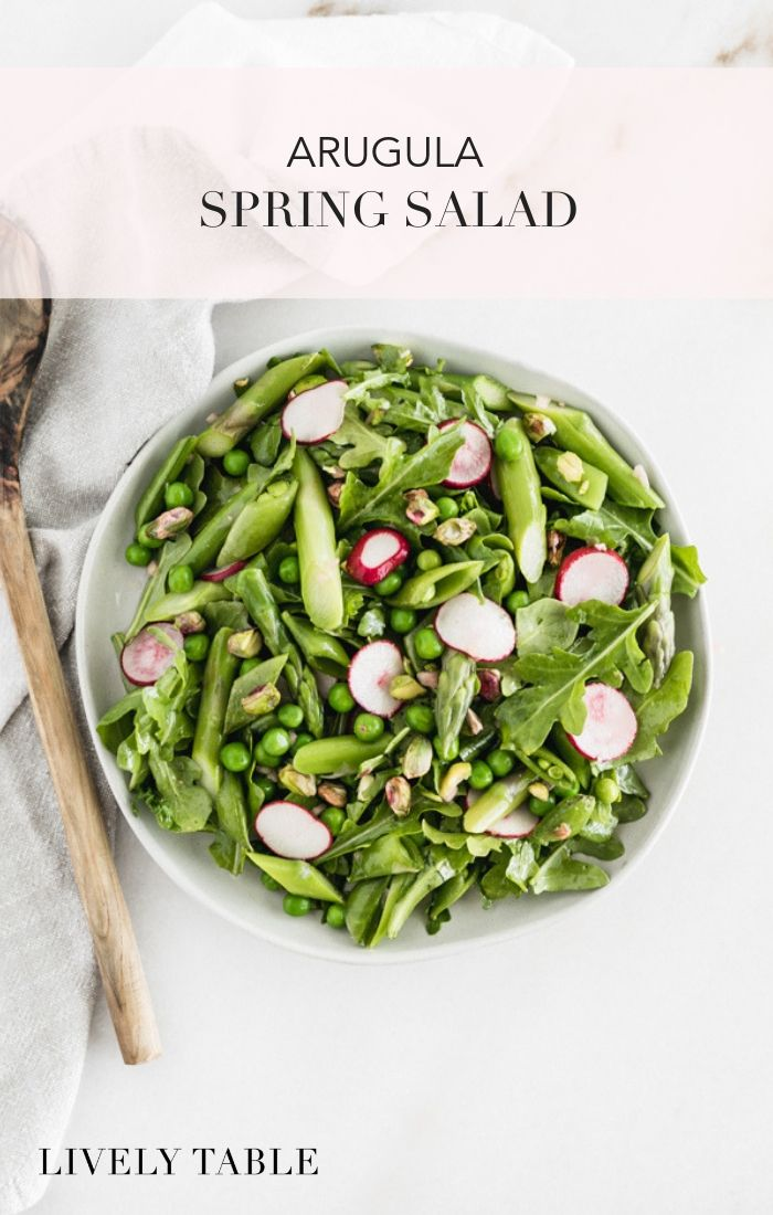 Celebrate the flavors of spring with this beautiful, fresh Arugula Spring Salad featuring peas, asparagus, radishes, mint and a simple lemon dressing. #vegan #glutenfree #arugula #salad #easyrecipe #simple #quickandeasy #springrecipes #springsalad #vegetarian #sidedish #sidesalad #under30minutes