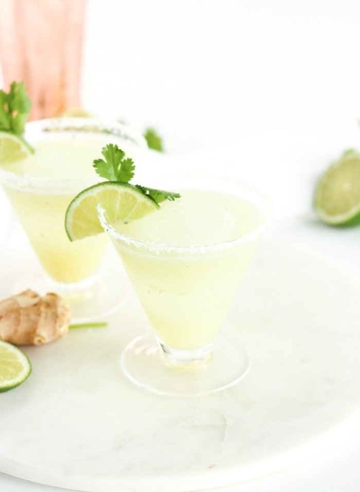 With a hint of Thai flavor, refreshing Lemongrass Cilantro Margaritas are a fun twist on margaritas to celebrate Cinco de Mayo or any occasion! Made with simple ingredients, you'll love these margaritas! | via livelytable.com