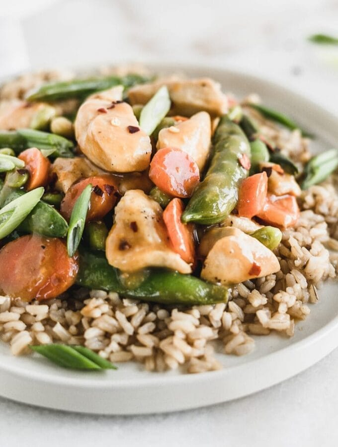 This healthy Orange Peel Chicken is a lighter version of your favorite takeout, bursting with flavor and tons of veggies! It's a delicious, one pan dinner perfect for weeknights! (no added sugar, gluten-free option) | via livleytable.com