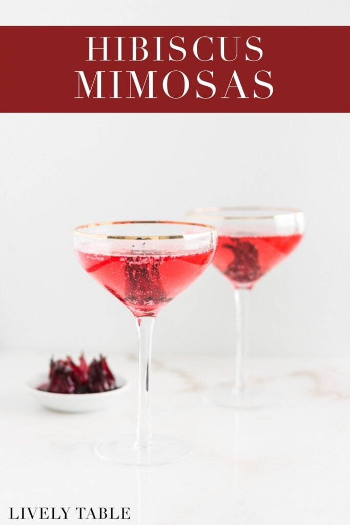two hibiscus mimosas in champagne coupes with text overlay.
