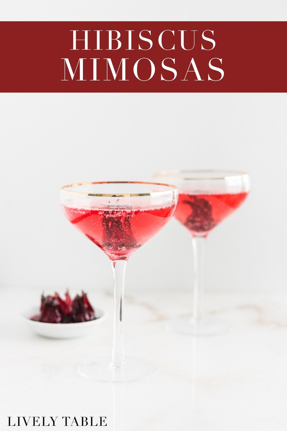 Hibiscus Mimosas areso pretty and easy to make for all of your spring and summer celebrations! #springcocktails #hibiscusmimosa #hibiscuscocktails #cocktails #easycocktails