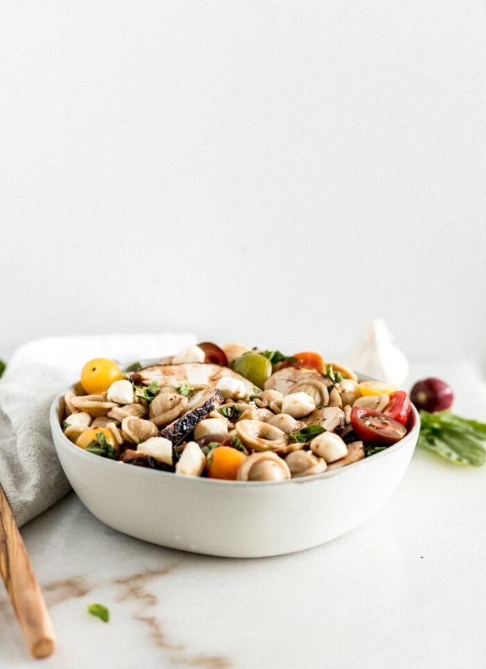 Chicken Caprese pasta salad in a bowl.