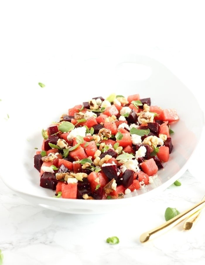This gorgeous watermelon beet salad is a refreshing summer salad for all of your cookouts and summer meals! (vegetarian, gluten-free) | via livelytable.com
