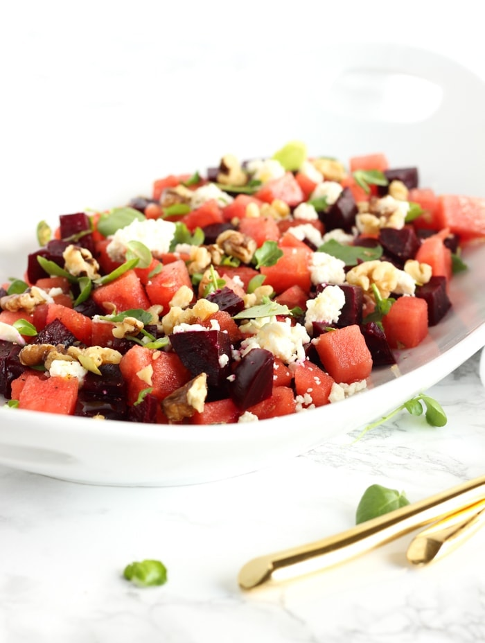 This gorgeous watermelon beet salad is a refreshing summer salad for all of your cookouts and summer meals! (vegetarian, gluten-free)   via livelytable.com
