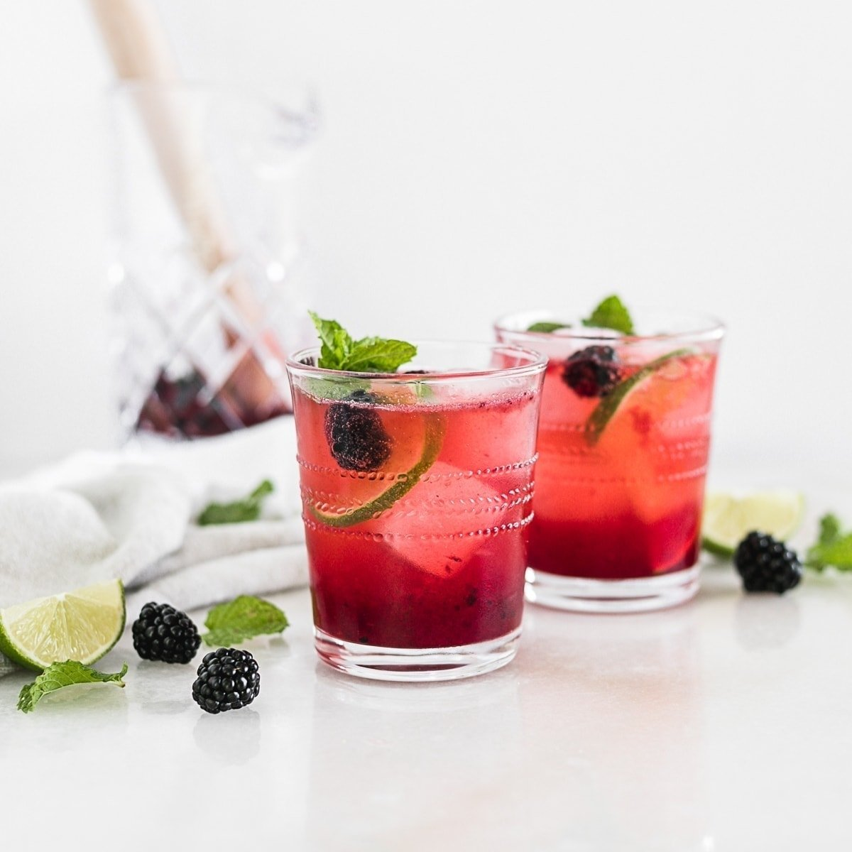 If you enjoy bourbon, you'll love this delicious blackberry bourbon smash, an bourbon cocktail with sweet summer blackberries, lemon and fresh muddled mint topped with bubbly soda. It's an easy and elegant summer sip!