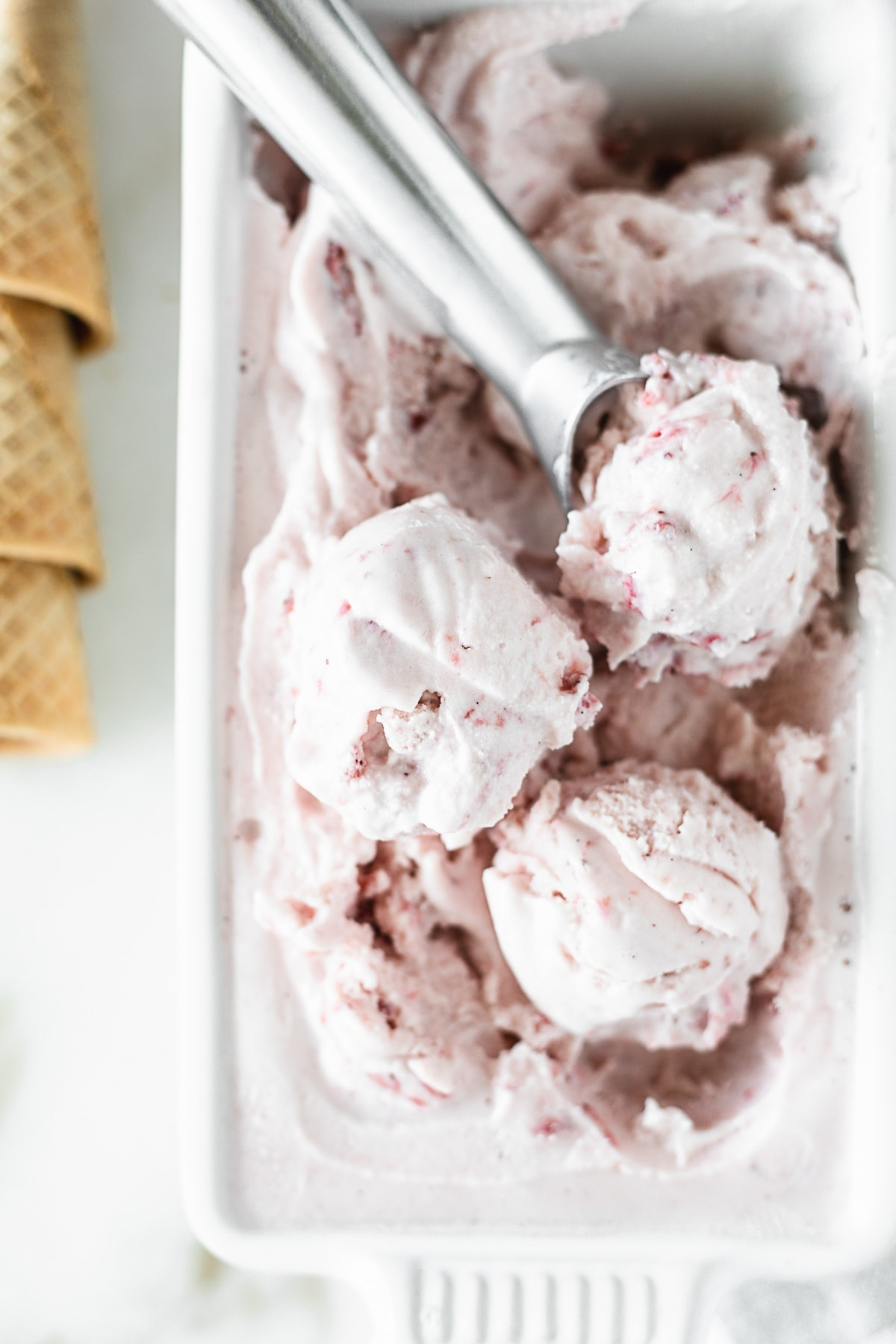 This homemade roasted strawberry ice cream is bursting with sweet strawberry flavor and is so easy to make with only 6 simple ingredients! It's a must-have dessert this summer! (gluten-free, vegetarian) | via livelytable.com