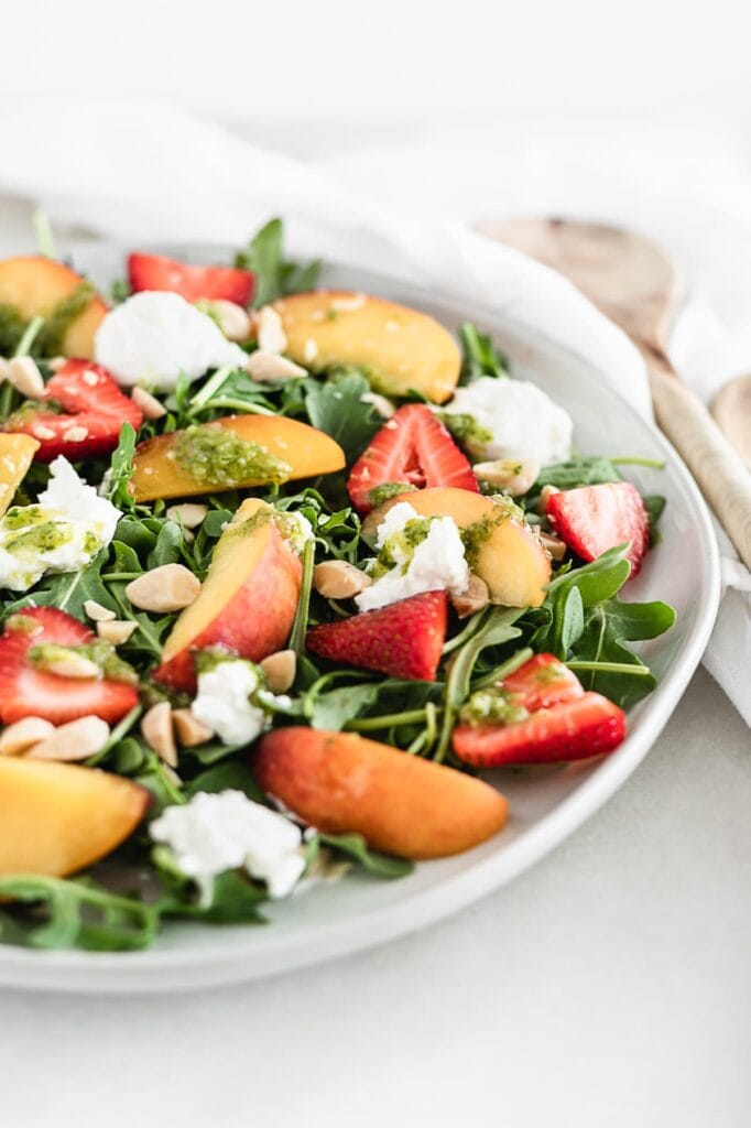 Close up of strawberry peach burrata salad.