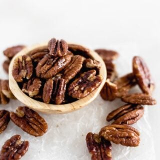 Easy 3 Ingredient Candied Pecans are sweet, crunchy, and perfect for the holidays! Add them to salads, oatmeal, or just snack on them. (gluten-free, refined sugar-free, vegan)