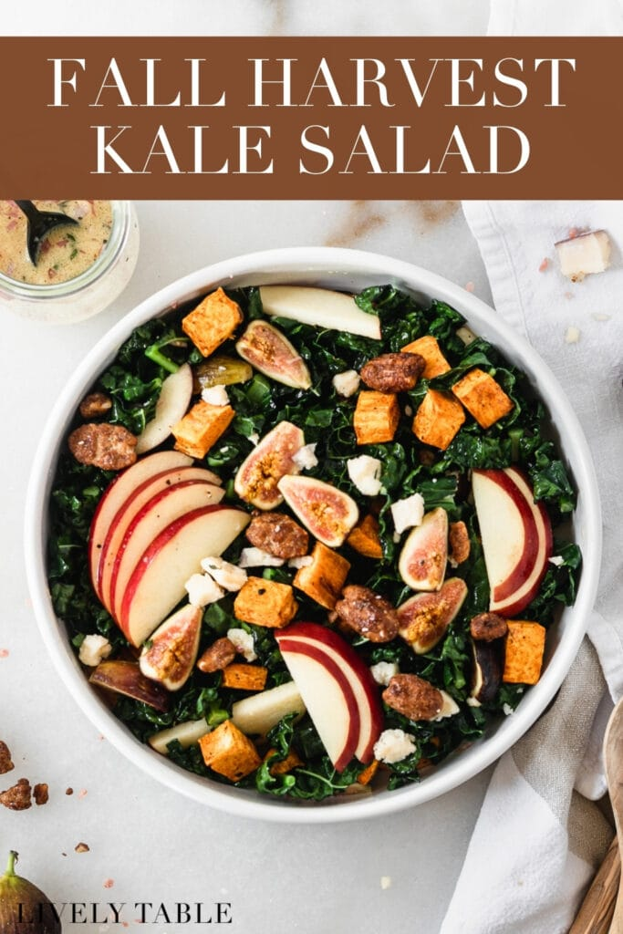 overhead view of fall harvest kale salad in a white bowl with text overlay.
