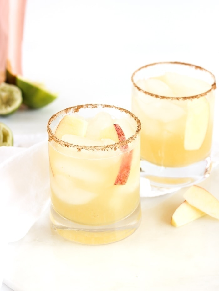Apple Cider Margaritas with cinnamon and ginger-salted rims are the perfect festive cocktails for fall! They're made with only a few simple ingredients and take just minutes to prepare! (gluten-free)
