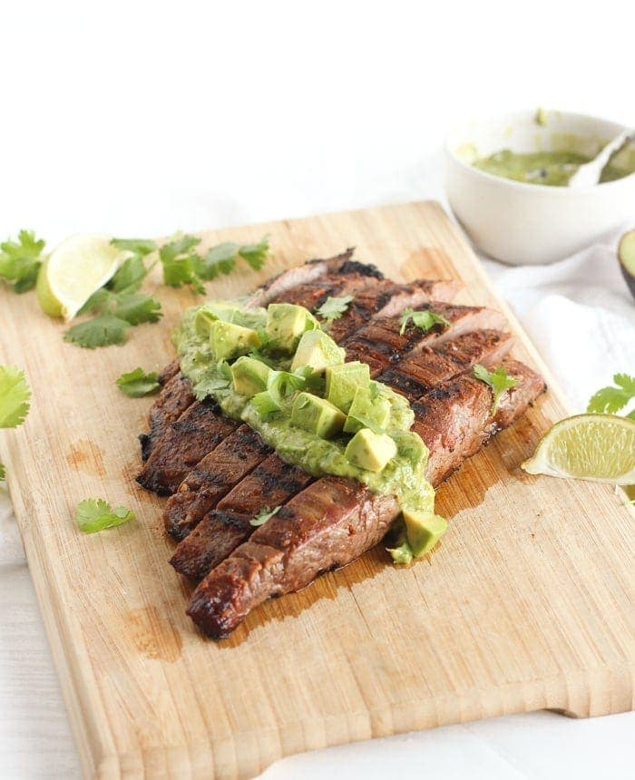 Simple Carne Asada with Avocado Chimichurri - this flavorful grilled flank steak topped with creamy avocado chimichurri sauce is an easy and delicious weeknight dinner your family will love! (gluten-free, dairy-free)