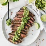 Simple Carne Asada with Avocado Chimichurri - this flavorful grilled flank steak topped with creamy avocado chimichurri sauce is an easy and delicious weeknight dinner your family will love! (#glutenfree, #dairyfree) | #steak #weeknightdinner #beef #chimichurri | via livelytable.com